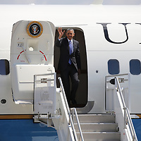 President Barack Obama waves as he exits Air Force One at the Orlando International Airport on Thursday, March 20, 2014 in Orlando, Fla., enroute to the Valencia Community College West campus to speak about the role of women in the U.S. economy, as well as the challenges they still face. (AP Photo/Alex Menendez)
