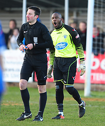 STRATFORD KEEPER LOUIS CONNOR PROTESTS WITH REFEREE RICHARD ELEY OVER KETTERINGS FIRST GOAL, Kettering Town v Stratford Town Evo Stik Southern League Latimer Park, Saturday 9th December 2017. Score 2-0
