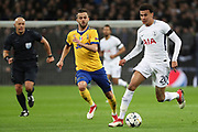 Dele Alli of Tottenham Hotspur (20) taking on Juventus midfielder Miralem Pjanic (5) during the Champions League match between Tottenham Hotspur and Juventus FC at Wembley Stadium, London, England on 7 March 2018. Picture by Matthew Redman.