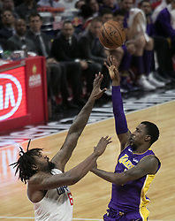 November 27, 2017 - Los Angeles, California, U.S - DeAndre Jordan #6 of the Los Angeles Clippers tries to block the shot of Kentavious Caldwell-Pope #1 of the Los Angeles Lakers on Monday November 27, 2017 at the Staples Center in Los Angeles, California. Clippers vs Lakers. (Credit Image: © Prensa Internacional via ZUMA Wire)