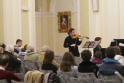Girl playing a violin at concert. (Photo by Vid Ponikvar / Sportida)
