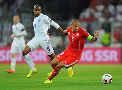 Switzerland's Gokhan Inler battles for the ball with England's Fabian Delph (Aston Villa)  - Photo mandatory by-line: Joe Meredith/JMP - Mobile: 07966 386802 - 08/09/14 - SPORT - FOOTBALL - Switzerland - Basel - St Jacob Park - Switzerland v England - Uefa Euro 2016 Group E Qualifier