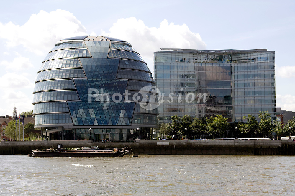 View of City Hall (Headquarters of the Greater London Authority) from boat on River Thames; London