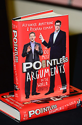 In the frame - Book titled 'The 100 Most Pointless Arguments in the World'.<br /> Alexander Armstrong and Richard Osman attend book signing. Stars of hit BBC series Pointless sign copies of their book The 100 Most Pointless Arguments in the World at Waterstones Leadenhall Market, Whittington Avenue, London, United Kingdom. Wednesday, 11th December 2013. Picture by Nils Jorgensen / i-Images