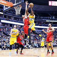 18 November 2016: Denver Nuggets guard Emmanuel Mudiay (0) goes to the basket against Toronto Raptors center Jonas Valanciunas (17) during the Toronto Raptors 113-111 OT victory over the Denver Nuggets, at the Pepsi Center, Denver, Colorado, USA.