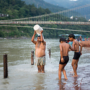 Devout Hindus bath along the Ganges River at Rishikesh, Uttarakhand, India.