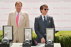 Left to right, THEO FENNELL andTOM CRUISE at the 2014 Glorious Goodwood Racing Festival at Goodwood racecourse, West Sussex on 31st July 2014.