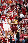 BLOOMINGTON, IN - JANUARY 12: Verdell Jones III #12 of the Indiana Hoosiers defends against Maverick Ahanmisi #13 of the Minnesota Golden Gophers at Assembly Hall on January 12, 2012 in Bloomington, Indiana. Minnesota defeated Indiana 77-74. (Photo by Joe Robbins)