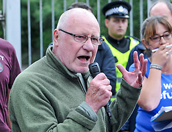 Pictured: Former Labour MP Dennis Canavan talks to the demonstrators.<br /> <br /> Protesters gathered outside the main Home Office building in Glasgow to protest at private company SERCO's attempts to evict failed asylum seekers from their homes.<br /> <br /> © Dave Johnston / EEm