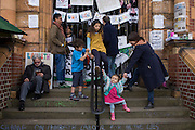 Campaigners on the steps of Carnegie Library in Herne Hill, south London while occupiers remain inside the premises on day 9 of its occupation, 8th April 2016. The angry local community in the south London borough have occupied their important resource for learning and social hub for the weekend. After a long campaign by locals, Lambeth have gone ahead and closed the library's doors for the last time because they say, cuts to their budget mean millions must be saved. (Photo by Richard Baker / In Pictures via Getty Images).