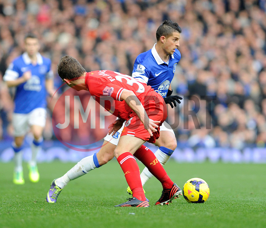 Everton's Kevin Mirallas passes Liverpool's Jon Flanagan - Photo mandatory by-line: Dougie Allward/JMP - Tel: Mobile: 07966 386802 23/11/2013 - SPORT - Football - Liverpool - Merseyside derby - Goodison Park - Everton v Liverpool - Barclays Premier League