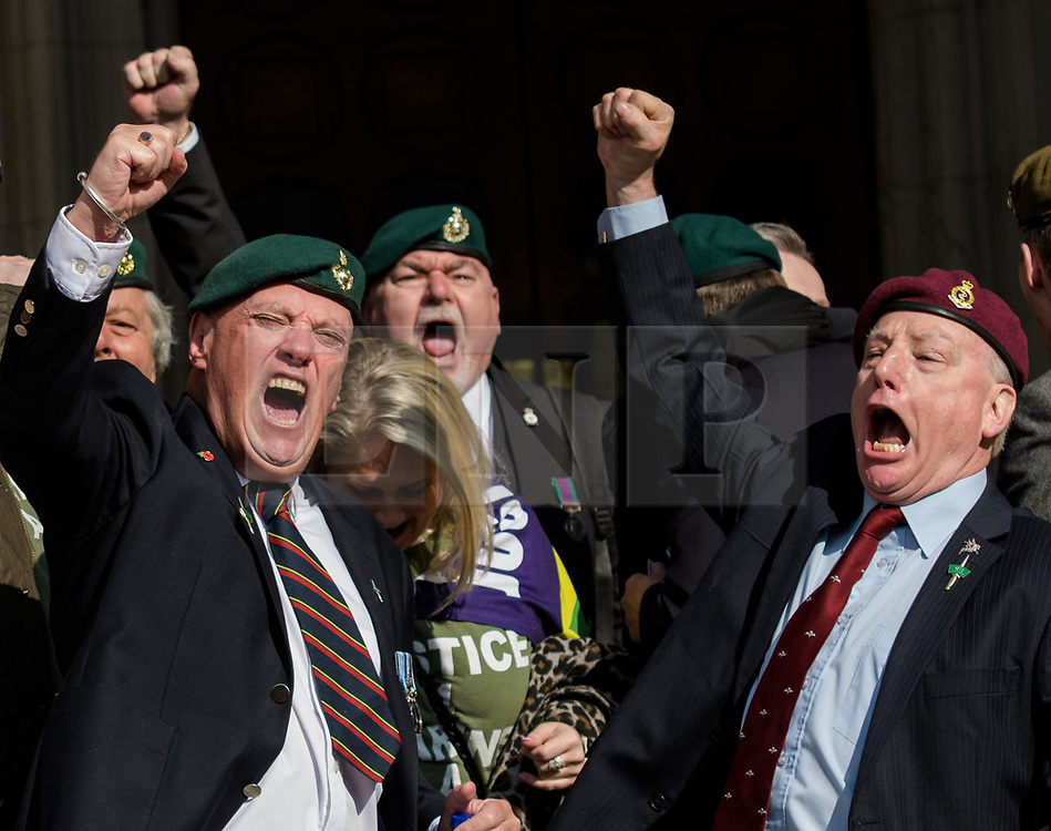 © Licensed to London News Pictures. <br /> 28/3/2017. London, Great Britain.  <br /> A Royal Marine and Paratrooper celebrate the news that Sgt. Al Blackman RM has had his murder conviction overturned to Manslaughter and should be released from prison within two weeks.<br /> Photo credit: Anthony Upton/LNP