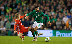 DUBLIN, IRELAND - Tuesday, October 16, 2018: Wales' George Thomas (L) is pushed over by Republic of Ireland's Cyrus Christie but no foul was awarded during the UEFA Nations League Group Stage League B Group 4 match between Republic of Ireland and Wales at the Aviva Stadium. (Pic by David Rawcliffe/Propaganda)
