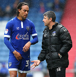 Oldham Athletic manager Stephen Robinson talks with Charles Dunne - Mandatory by-line: Matt McNulty/JMP - 03/09/2016 - FOOTBALL - Sportsdirect.com Park - Oldham, England - Oldham Athletic v Shrewsbury Town - Sky Bet League One