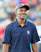 Former Indianapolis Colts wide receiver Marvin Harrison smiles while being announced over the public address system as he walks onto the field as a new member of the Pro Football Hall of Fame before the 2016 NFL Pro Football Hall of Fame preseason football game against the Green Bay Packers on Sunday, Aug. 7, 2016 in Canton, Ohio. The game was canceled for player safety reasons due to the condition of the paint on the turf field. (©Paul Anthony Spinelli)
