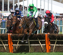 LIVERPOOL, ENGLAND - Thursday, April 8, 2010: Kayf Aramis ridden by Paddy Brennan jumps a fence during the opening day of the Grand National Festival at Aintree Racecourse. (Pic by David Rawcliffe/Propaganda)