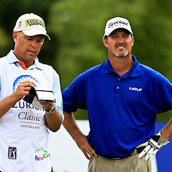 2009 April 26: Jeff Kelly of Madison, WI with his caddie on the 15th hole during the final round of the Zurich Classic of New Orleans PGA Tour golf tournament played at TPC Louisiana in Avondale, Louisiana.