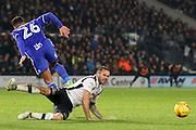 Birmingham City midfielder David Davis brings down Derby County midfielder Bradley Johnson during the EFL Sky Bet Championship match between Derby County and Birmingham City at the iPro Stadium, Derby, England on 27 December 2016. Photo by Aaron  Lupton.