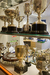 Collection of School Trophies on a shelf,