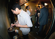 Customers enjoy drinks and food at tiny Uminoie in Sendagaya, Tokyo.