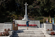 A female military officer from lays a wreath and salutes during a ceremony for Remembrance Sunday at the Commonwealth War Graves Cemetery in Hodogaya, Yokohama, Japan. Sunday November 13th 2016. Each year representatives of the Commonwealth nations, along with American and other European nations that lost servicemen fighting the Japanese in World War 2, hold a multi-faith service of remembrance at this cemetery. This is the only cemetery for war dead in japan that is managed by the Commonwealth War Graves Commission.