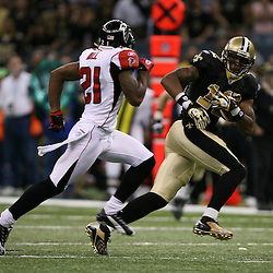 2007 October, 21: New Orleans Saints wide receiver Marques Colston (12) runs away from Falcons defensive back DeAngelo Hall (21) during a 22-16 win by the New Orleans Saints over the Atlanta Falcons at the Louisiana Superdome in New Orleans, LA.
