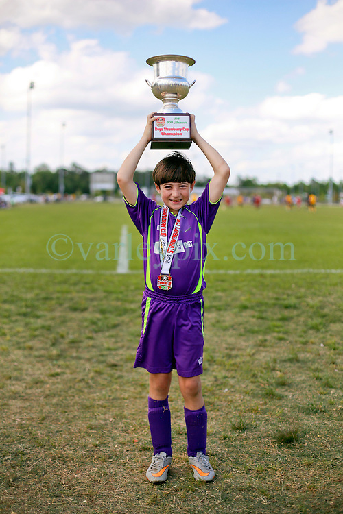 10 April 2016. Hammond, Louisiana.<br /> South Tangi Youth Soccer Association (STYSA), Chappapeela Sports Complex, 30th Annual Strawberry Cup,  <br /> New Orleans Jesters Youth Academy U10 team Purple celebrate victory over CD Motagua in the Cup Final.<br /> Jesters won 5-4 to become Strawberry Cup Champions for the 2nd year running. <br /> Photo&copy;; Charlie Varley/varleypix.com
