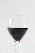 Cutout of a glass of red wine on white background