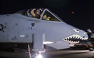 An American Air Force pilot flexes his biceps in a show of power as he taxis to runway to take off on another sortie in his A-10 fighter headed for Iraq. Air Force flies sorties out of an undisclosed air base near Iraq Monday March 24, 2003. (Alan Lessig/Air Force Times)