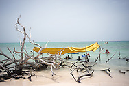 Makeshift shelter at Cayo Jutias beach in Pinar del Rio. <br /> Cayo Jutias is a remote beach to access, but it is also very popular, so people come on buses and in convoys from early in the morning and spend the whole day until sun down. <br /> <br /> Cayo Jutias, Pinar del Ri, Cuba, 2015o