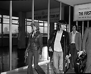"""Arrivals of Eric Clapton and Judy Geeson at DAP..1975..13.09.1975..09.13.1975..13th September 1975..Today saw the arrivals of musician Eric Clapton and actress Judy Geeson at Dublin Airport. They are in Ireland to take part in """"Circasia 75"""" at Straffan House,Co Kildare..Image shows the arrival of Eric Clapton at the airport ,he was accompanied by Patti Harrison as they strolled from the aircraft."""