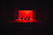 The troupe of the Kosovo National Ballet performs Where the Light Falls coreographed by Antonio Pio Fini at the National Theater of Kosovo, Pristina. In the years following the Kosovo conflict aftermath their audiences are mostly the people from foreign missions and NGO's stationed in the country. Nowadays they try to attract more general audiences who are charged as low as 3 euro for their regular show to reintroduce them the ballet.