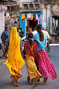 Indian family shopping in old town Udaipur, Rajasthan, Western India, Hindus and Muslims together.