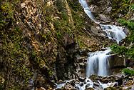 A long waterfall down a mountainside