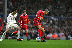 LIVERPOOL, ENGLAND - SUNDAY MARCH 27th 2005: Liverpool Legends' Ian Rush back-heels to Kenny Dalglish as Celebrity XI's Ralf Little looks on during the Tsunami Soccer Aid match at Anfield. (Pic by David Rawcliffe/Propaganda)