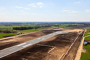 Nederland, Drenthe, Eelde, 01-05-2013; Groningen Airport Eelde, de verlengde start- en landingsbaan 05<br /> Runway of Groningen Airport Eelde seen from the helicopter.<br /> luchtfoto (toeslag op standard tarieven)<br /> aerial photo (additional fee required)<br /> copyright foto/photo Siebe Swart
