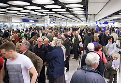 © Licensed to London News Pictures. File picture dated 21/11/2011. London, UK. Passengers squeeze into the passport checking area of Heathrow's Terminal 5  UK Border Agency control. Air passengers have been warned they could face long delays over Easter due to a staff shortage at passport controls. Photo credit: LNP