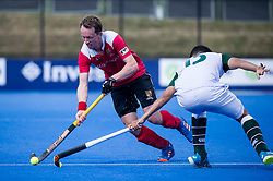 Holcombe's Dan Fox goes past Arjan Drayton-Chana of Surbiton. Holcombe v Surbiton - Semi-Final - Men's Hockey League Finals, Lee Valley Hockey & Tennis Centre, London, UK on 22 April 2017. Photo: Simon Parker