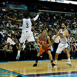 08 April 2009: Phoenix Suns guard Goran Dragic (2) is defended by New Orleans Hornets guard Chris Paul (3) and forward Peja Stojakovic (16) during a 105-100 loss by the New Orleans Hornets to the Phoenix Suns at the New Orleans Arena in New Orleans, Louisiana.