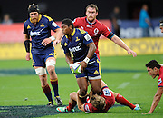 Waisake Naholo in action for the Highlanders. Investec Super Rugby - Highlanders v Reds 27 February 2015, Forsyth Barr Stadium, Dunedin, New Zealand. Photo: New Zealand. Photo: Richard Hood/www.photosport.co.nz