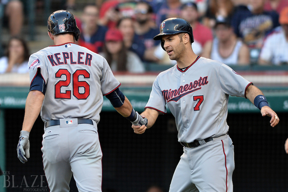 Aug 1, 2016; Cleveland, OH, USA; Minnesota Twins right fielder Max Kepler (26) and first baseman Joe Mauer (7) celebrate Kepler's first inning home run against the Cleveland Indians at Progressive Field. Mandatory Credit: Ken Blaze-USA TODAY Sports