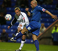Photo: Rich Eaton.<br /> <br /> Peterborough United v Swansea City. Johnstone's Paint Trophy. 31/10/2006. Thomas Butler of Swansea tries a shot on goal, blocked by Guy Branston of Peterborough