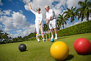 Image of a couple playing croquet showing an active lifestyle in a retirement community in Florida.