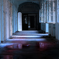 A corridor with peeling paint in an old hospital in east Germany