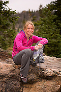 Portait of professional boulderer, Angie Payne resting between problems in Chaos Canyon, Rocky Mountain National Park.