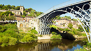 Iron Bridge, widely recognised as an iconic symbol of the industrial revolution, town of Ironbridge, Shropshire, United Kingdom, 2017-08-28.<br /><br />Built in 1779, the Iron Bridge was the first completed bridge structure made of cast iron in the world, inspiring architectures and designers for future generations.
