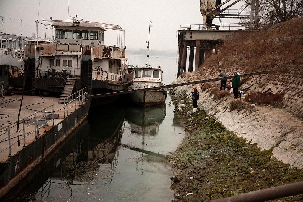Fishermen in the port of Prahovo, Serbia..Matt Lutton for the Financial Times.