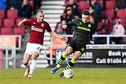 Forest Green Rovers forward (on loan from Celtic) Jack Aitchison (29)  battles for possession  with` Northampton Town defender Michael Harriman (23) during the EFL Sky Bet League 2 match between Northampton Town and Forest Green Rovers at the PTS Academy Stadium, Northampton, England on 14 December 2019.