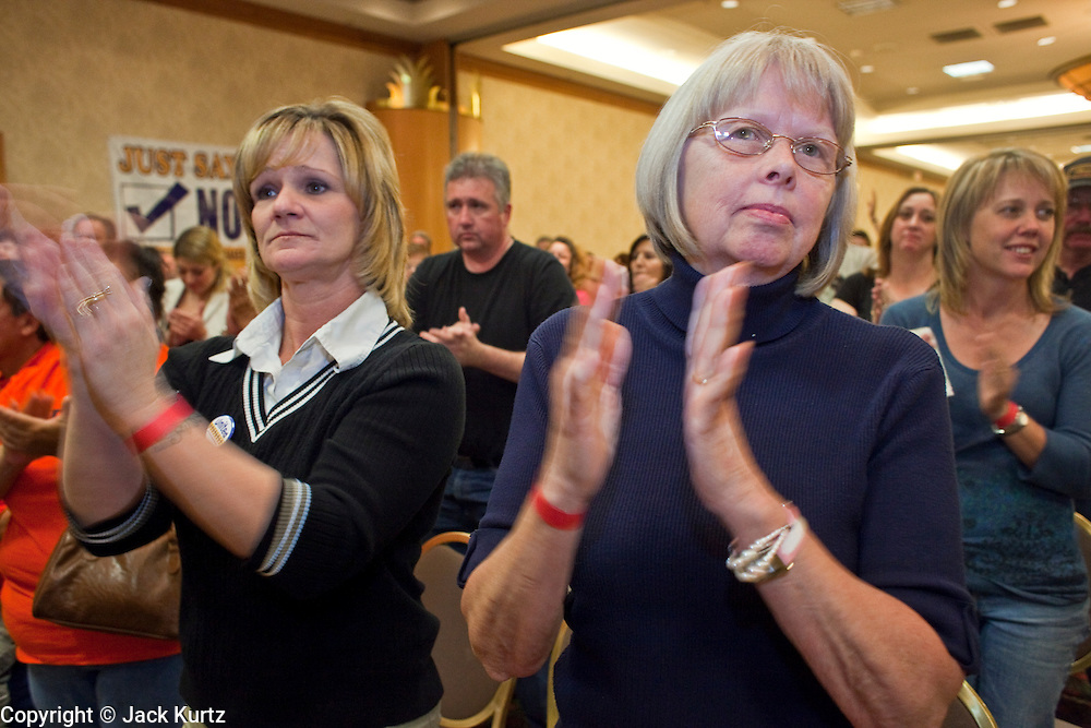 Nov. 11, 2009 -- PHOENIX, AZ: LISA REECE (left) and ELAINE GEISER, employees of a Frys' store in Glendale, AZ, cheer during a meeting of members of the UFCW at the Airport Marriott Hotel in Phoenix. The United Food and Commercial Workers Union (UFCW) Local 99 has about 25,000 members in Arizona: 15,000 in Fry's grocery stores and Fry's Marketplace, 9,500 in Safeway stores and 400 in Smith's grocery stores. The union voted down the last proposal from the stores and has announced plans to go on strike at 6PM on Friday, Nov. 13. The meeting Wednesday is the last one before the strike.   Photo by Jack Kurtz