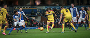 Joe Newell (Rotherham United) takes a shot and hyper-extends his leg. The shot is dealt with by the Blackburn defenders during the Sky Bet Championship match between Blackburn Rovers and Rotherham United at Ewood Park, Blackburn, England on 11 December 2015. Photo by Mark P Doherty.